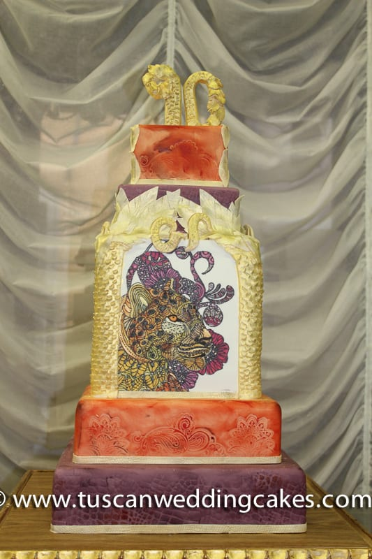 Tuscan Wedding Cakes - custom birthday cake by Florence cake designer. Inspired by images from Sri Lanka for a 90th birthday. Inside the tiered cake was Tuscan Wedding Cakes signature dark raspberry cake . As pictured serves 220/ 2,400 euros.