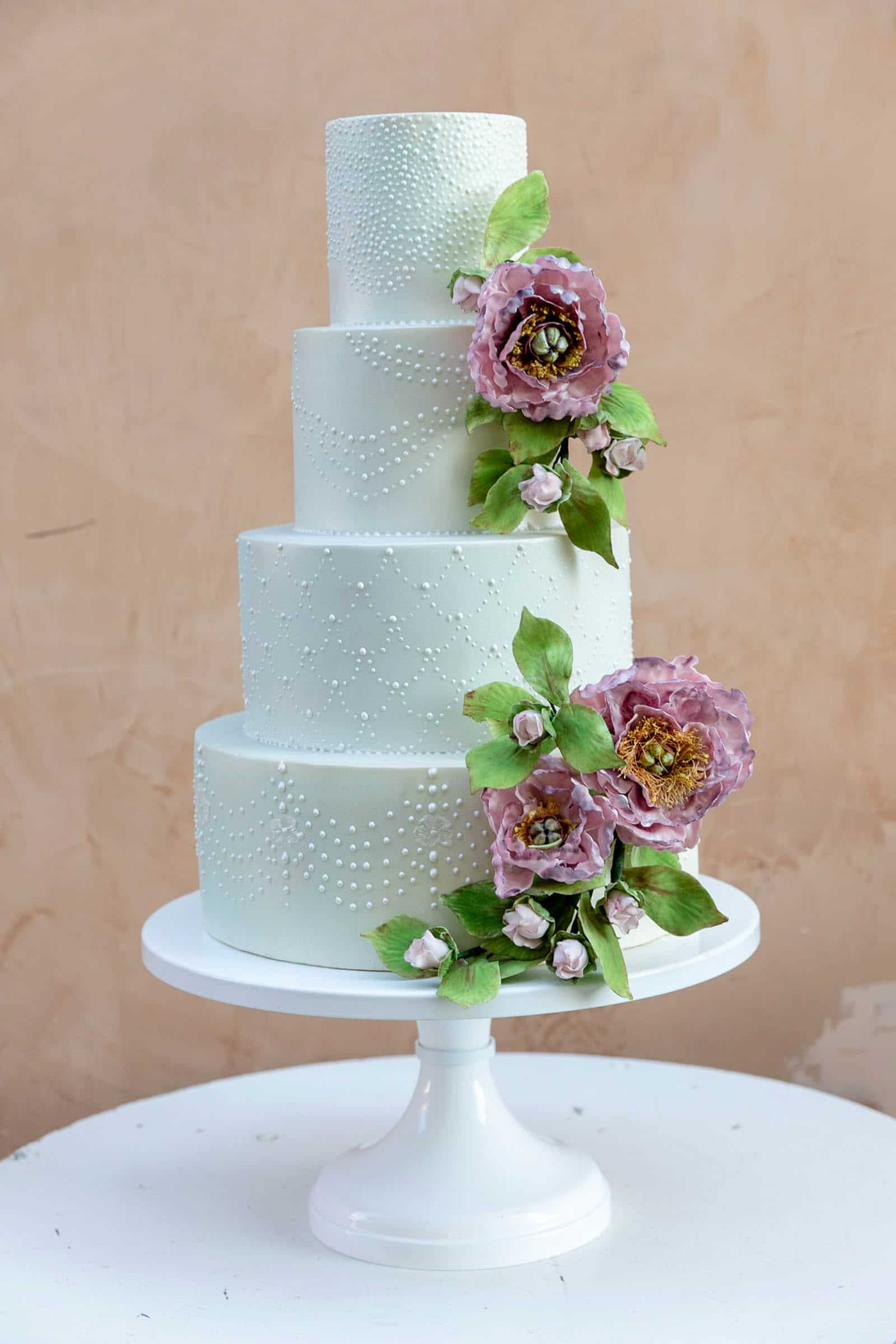 Modern tiered cake with classic piped pearls and sugar peonies by Tuscan Wedding Cakes